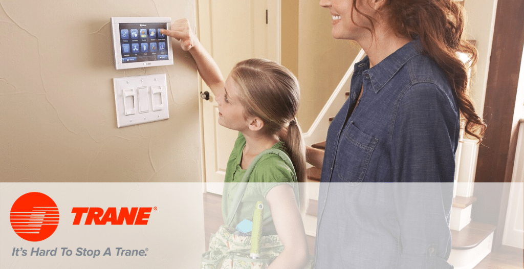 Girl using Nexia Smart Thermostat from Trane